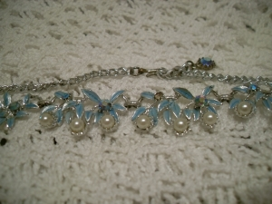 Silver tone. Soft blue leaves. White pearl beads. Aurora beads inset. Hook clasp.