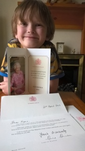 Norah's 6th Great Grandson with his letter from Her Majesty - in celebration of her 90th Birthday.